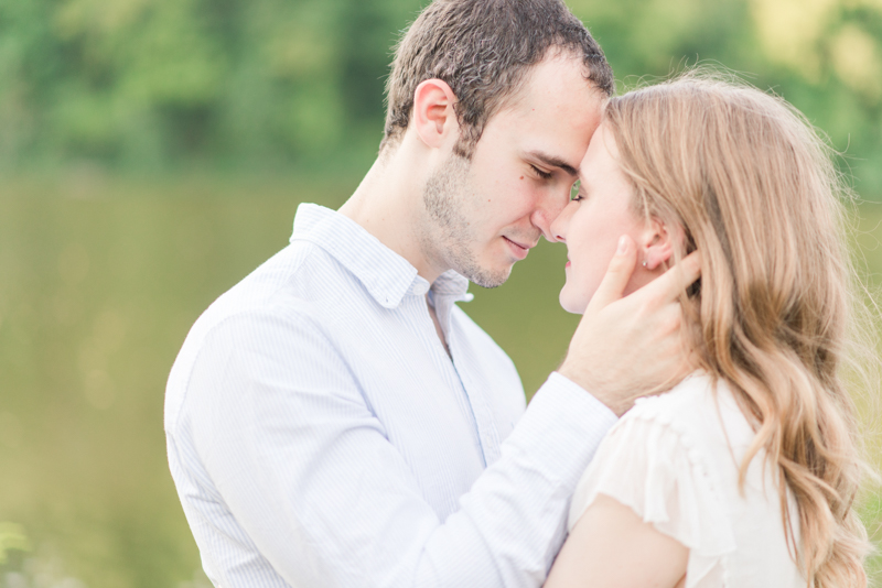 Couple at engagement session cuddling and touching foreheads