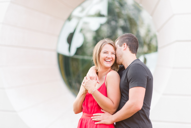 Couple during engagement session smiling and cuddling