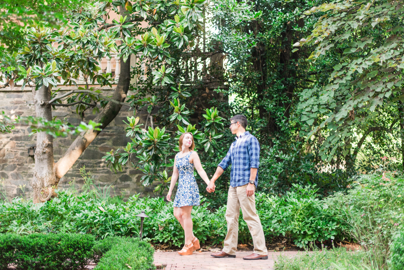 Couple at engagement session walking while holding hands