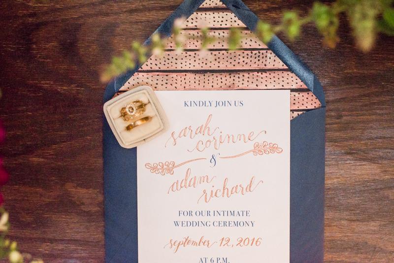 Wedding invitations and rings at La Cuchara Baltimore styled shoot