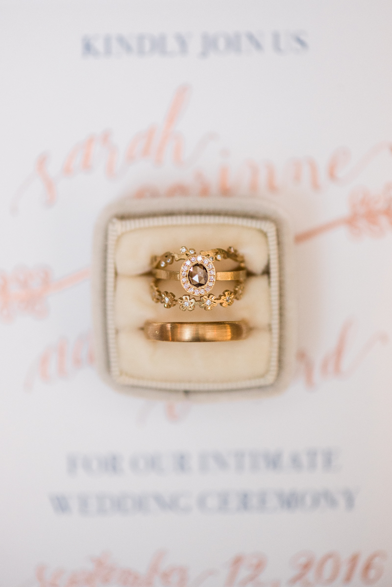Wedding invitations and rings at La Cuchara Baltimore styled shoot