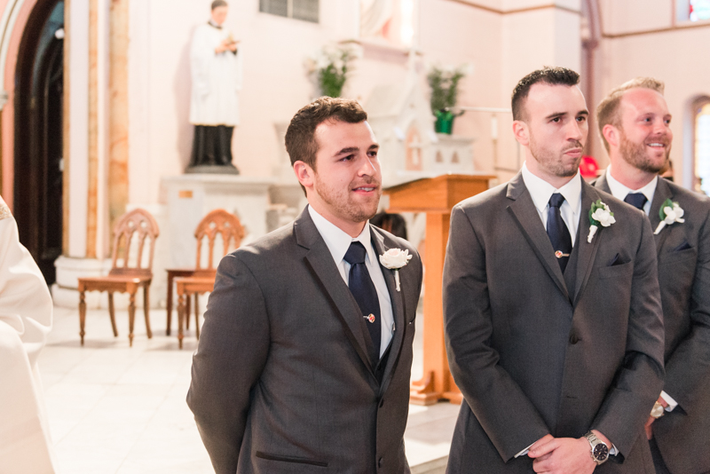 pier 5 hotel wedding baltimore maryland photographer holy cross catholic church emotional groom