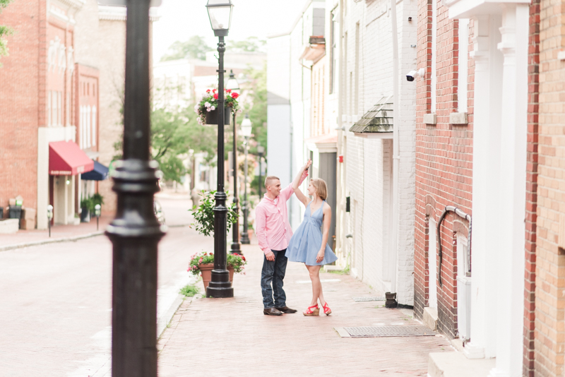 Wedding Photographers in Maryland Downtown Annapolis Engagement Session Sunrise Pastel Main Street Dancing