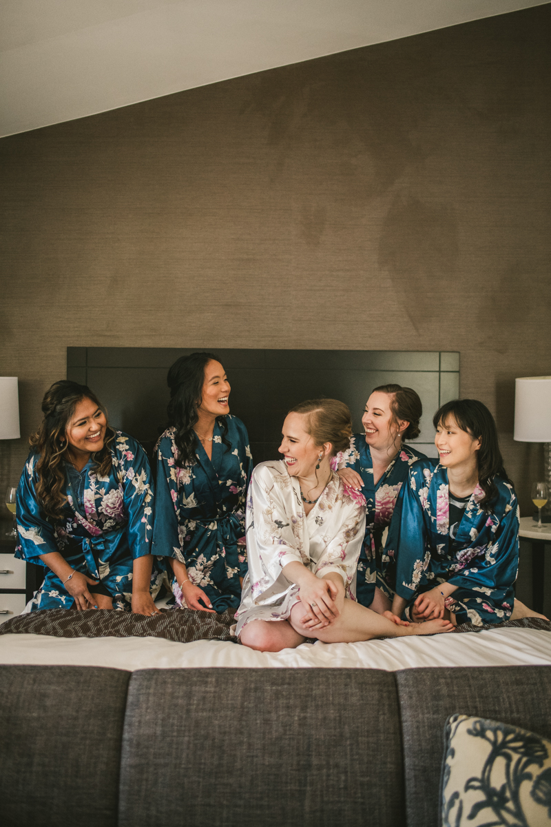 Industrial chic April wedding bridal party in Baltimore City's Radisson Hotel by Britney Clause Photography