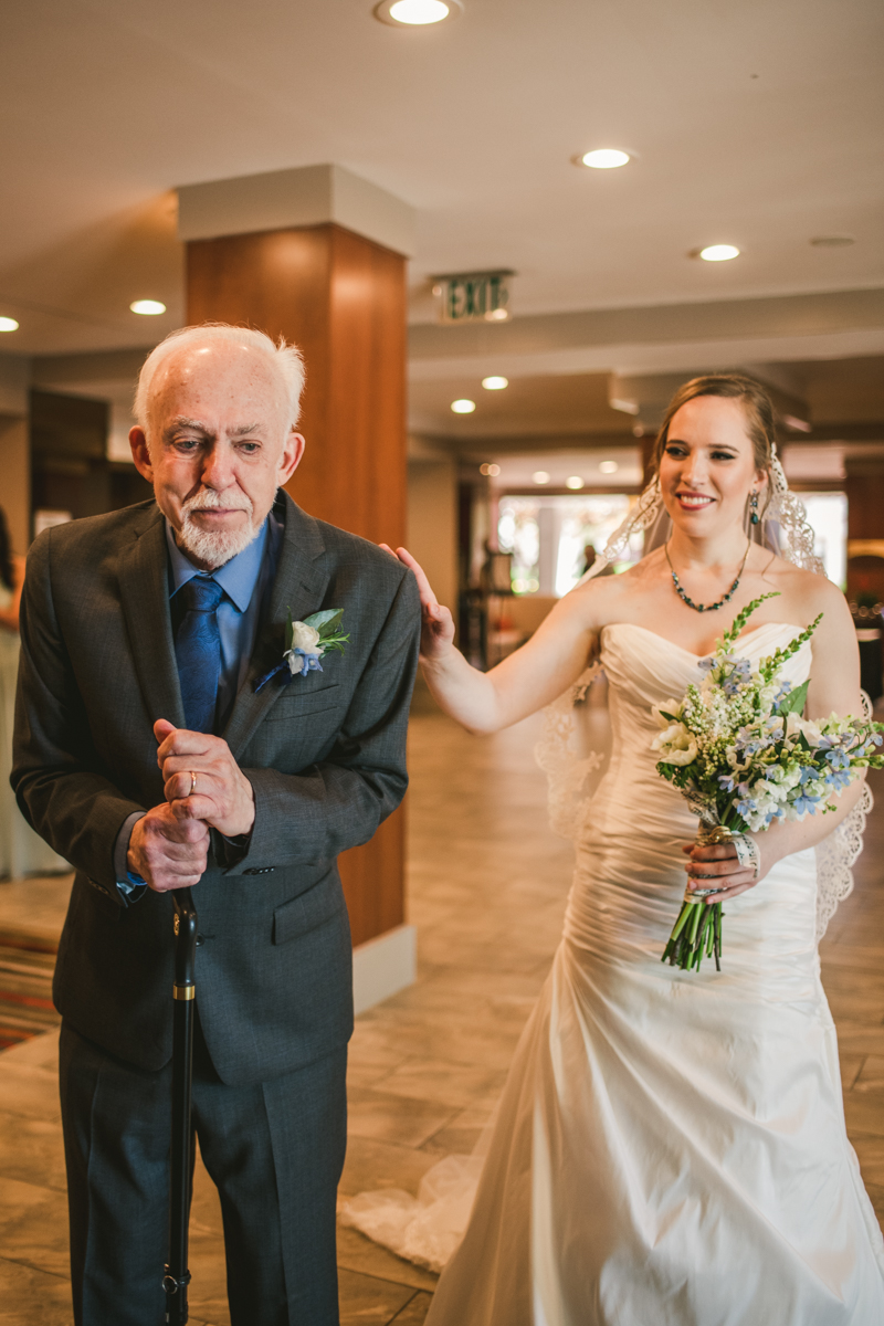 Industrial chic April wedding Father Daughter first look in Baltimore City's Radisson Hotel by Britney Clause Photography