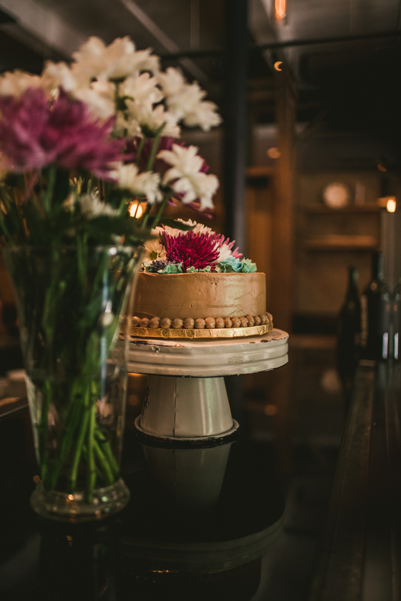 Industrial chic April wedding reception in Baltimore City at La Cuchara cake by Britney Clause Photography