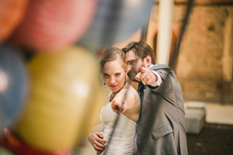Industrial chic April wedding bride and groom portraits in Baltimore City at Clipper Mill glass sculpture by Britney Clause Photography