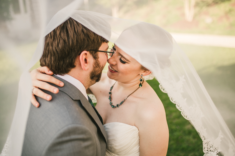 Industrial chic April wedding after party bride and groom portraits veil shot in Baltimore City at Union Mill Apartments by Britney Clause Photography