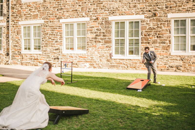 Industrial chic April wedding after party cornhole in Baltimore City at Union Mill Apartments by Britney Clause Photography