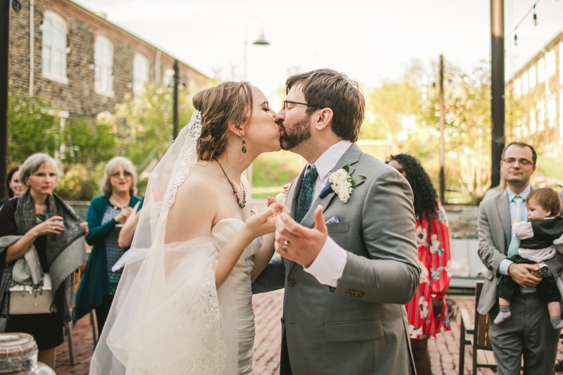 Industrial chic April wedding after party cake cutting in Baltimore City at Union Mill Apartments by Britney Clause Photography