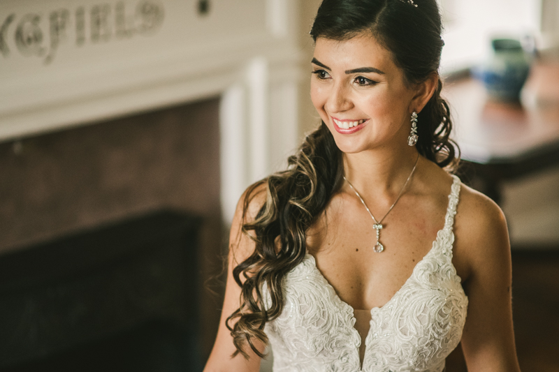 A beautiful stormy April wedding at Springfield Manor in Thurmont Maryland wedding dress from Cameo Bridal with makeup and hair styled by Airbrush Faces