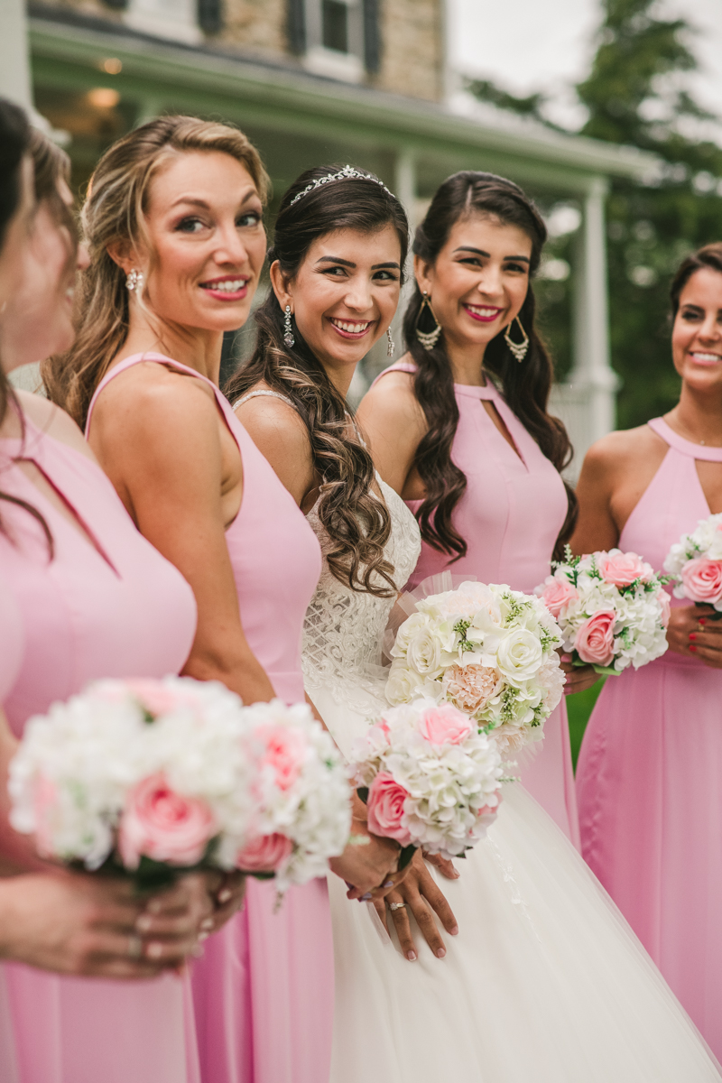A beautiful stormy April wedding at Springfield Manor in Thurmont Maryland pink bridesmaids dresses from Azazie