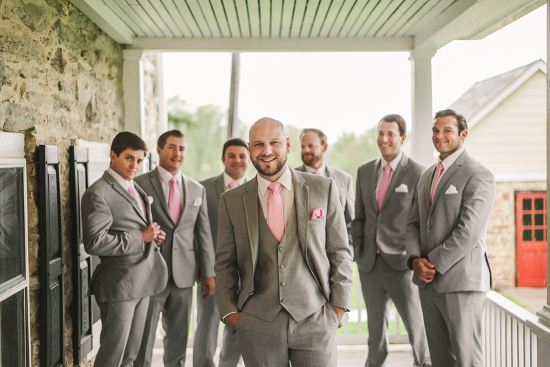 A beautiful stormy April wedding at Springfield Manor in Thurmont Maryland groomsmen on the front porch