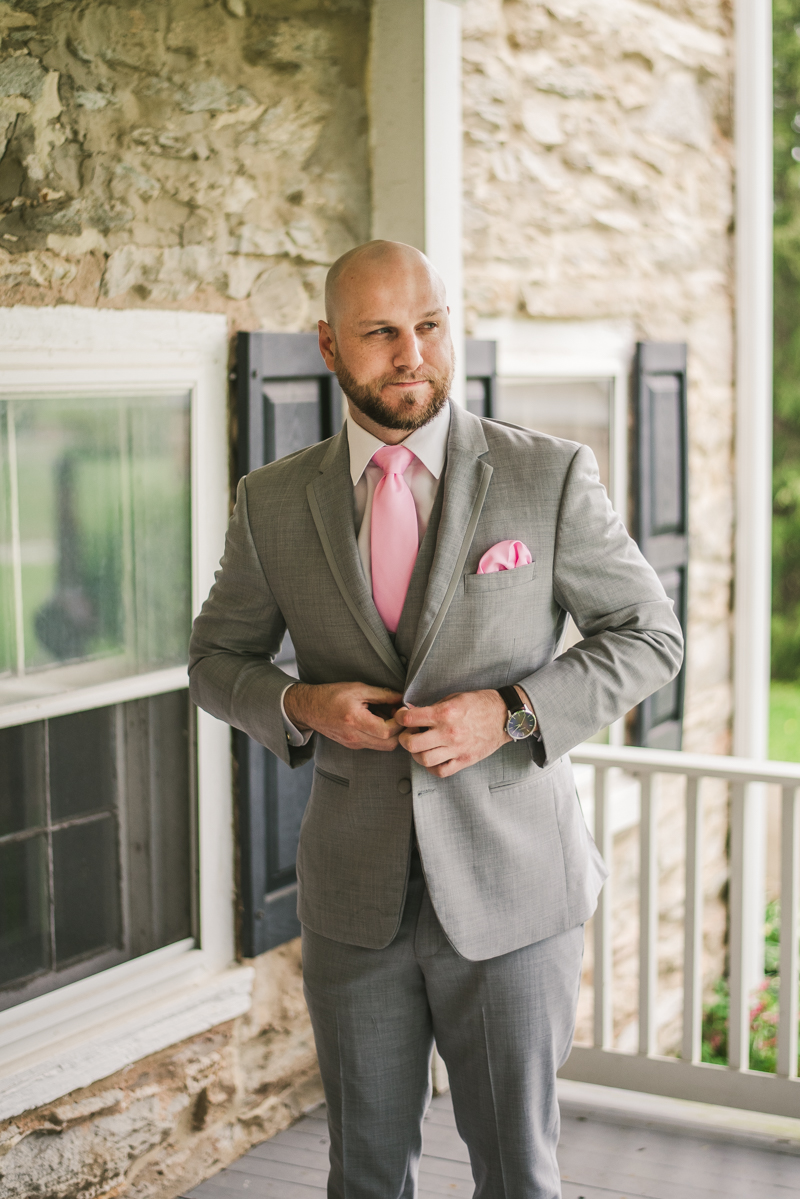 A beautiful stormy April wedding at Springfield Manor in Thurmont Maryland groom details buttoning jacket