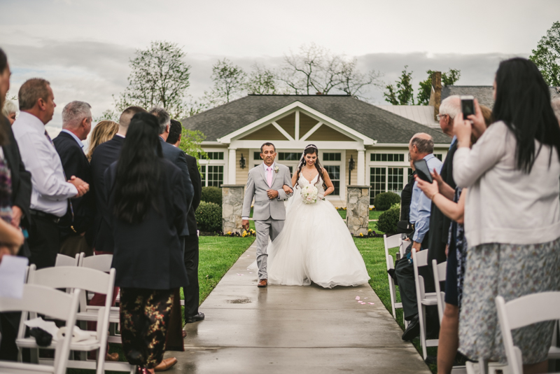 A beautiful stormy April wedding ceremony at Springfield Manor in Thurmont Maryland