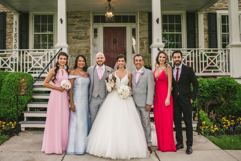 A beautiful stormy April wedding at Springfield Manor in Thurmont Maryland family formals in front of manor