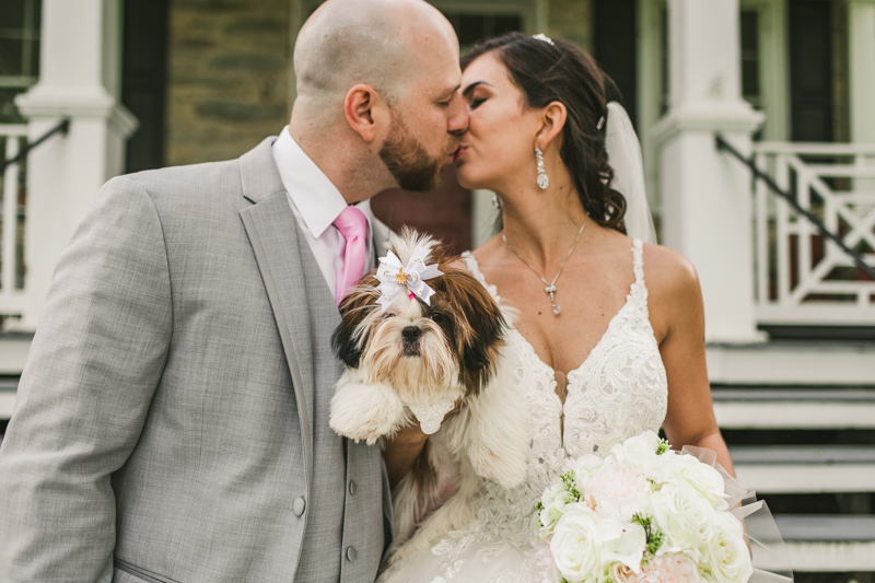 A beautiful stormy April wedding at Springfield Manor in Thurmont Maryland bride and groom portraits taken with puppy