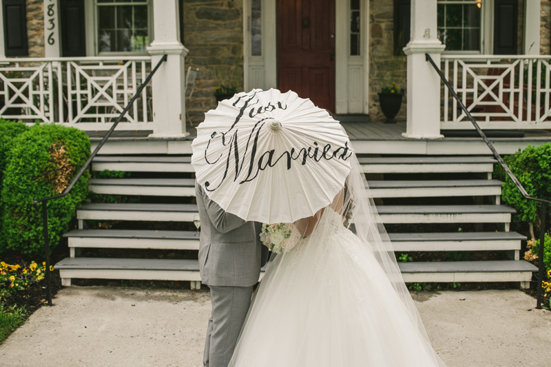 A beautiful stormy April wedding at Springfield Manor in Thurmont Maryland bride and groom portraits with just married parasol