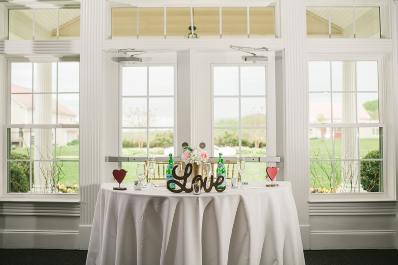A beautiful stormy April wedding reception sweetheart table at Springfield Manor in Thurmont Maryland