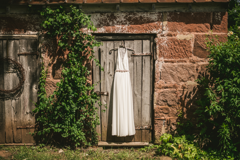 A gorgeous summer wedding dress at Rocklands Farm Winery in Poolesville, Maryland by Britney Clause Photography a husband and wife wedding photographer team in Maryland