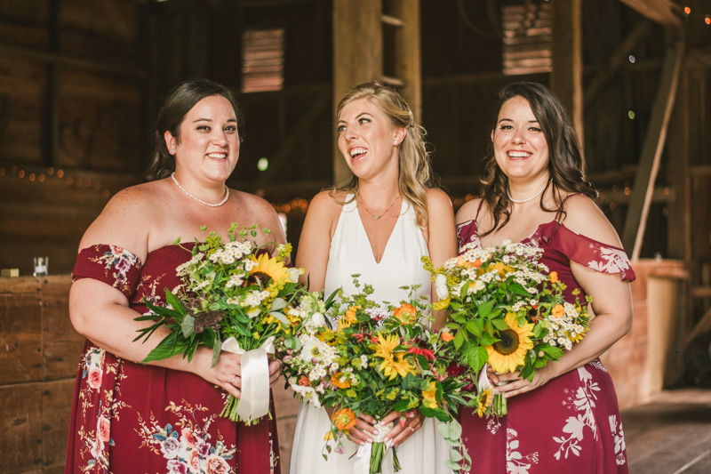 Gorgeous summer wedding florals by Sungold Flower Co at Rocklands Farm Winery in Poolesville, Maryland by Britney Clause Photography a husband and wife wedding photographer team in Maryland