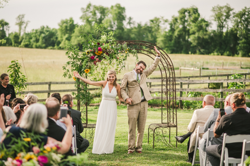 A gorgeous summer wedding ceremony at Rocklands Farm Winery in Poolesville, Maryland by Britney Clause Photography a husband and wife wedding photographer team in Maryland