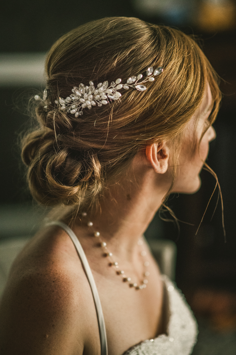 A bride getting ready for her wedding at Governor Calvert House in Downtown Annapolis by Britney Clause Photography, wedding photographers in Maryland
