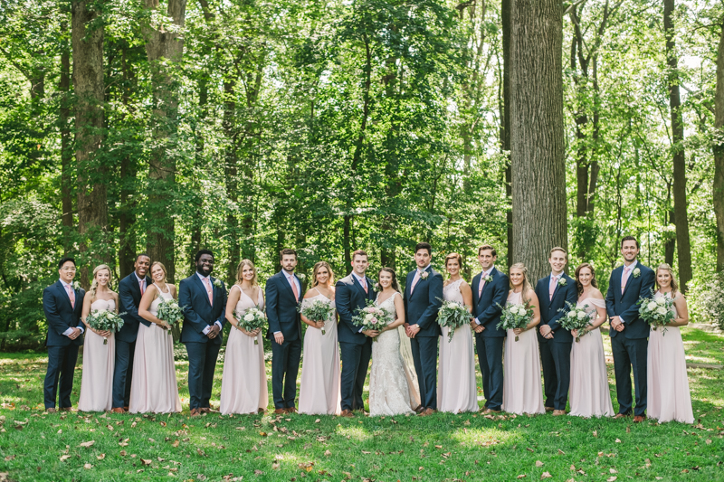 Posing a gorgeous large bridal party at Liriodendron Mansion in Bel Air, Maryland by Britney Clause Photography