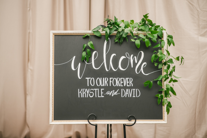 Beautiful DIY ceremony welcome sign at Main Street Ballroom in Ellicott City by Britney Clause Photography