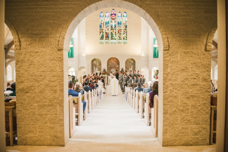 Gorgeous wedding ceremony at Jesus the Good Shepherd Church in Owings in Maryland. Photo by Britney Clause Photography