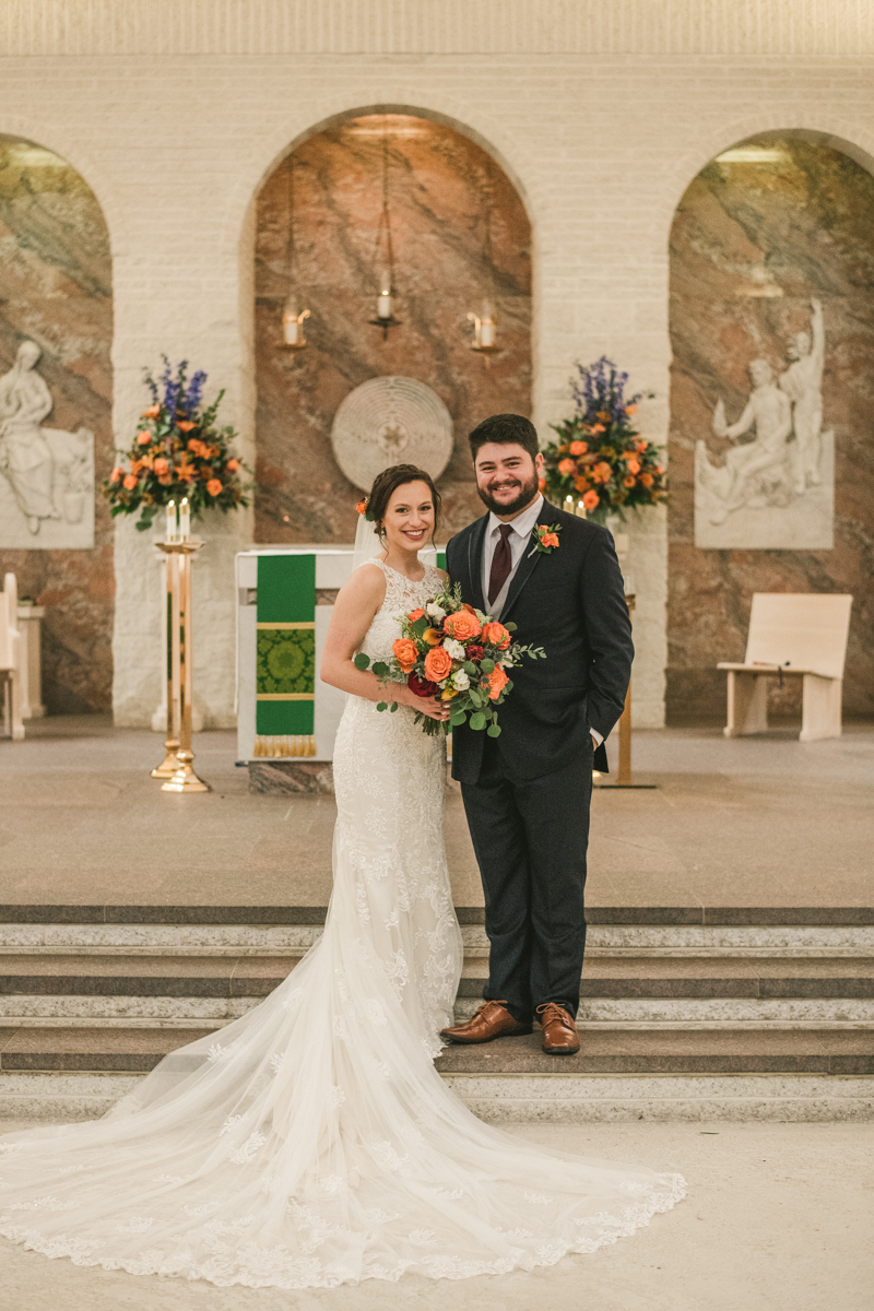 Stunning fall bride and groom just married portraits at Jesus the Good Shepherd Church in Owings in Maryland. Photo by Britney Clause Photography