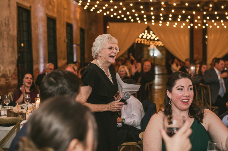 A stylish wedding reception at Mt Washington Mill Dye House in Baltimore, Maryland. Captured by Britney Clause Photography