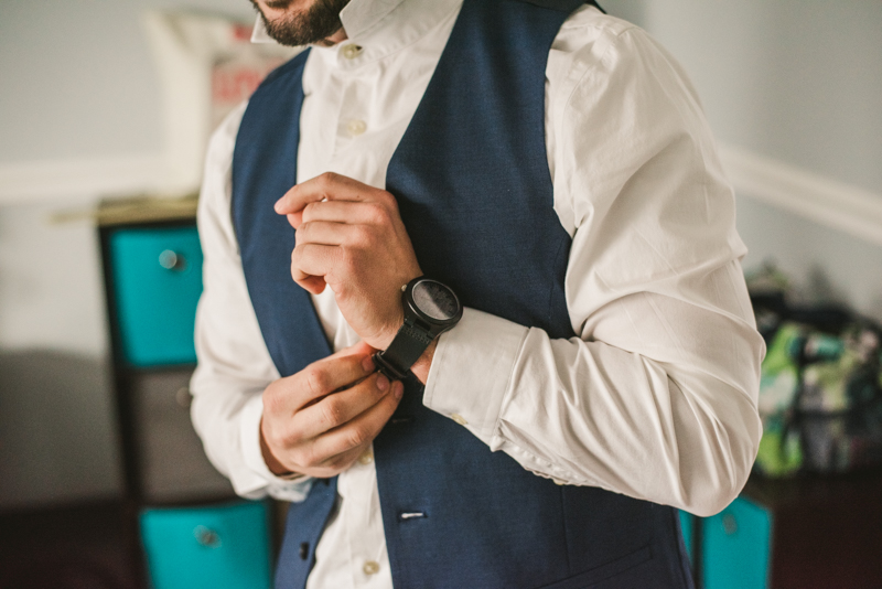 A groom getting ready for his wedding in Pasadena, Maryland by Britney Clause Photography