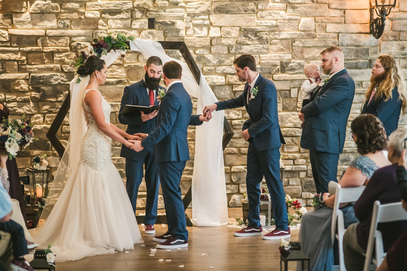 A gorgeous wedding ceremony at Kurtz's Beach in Pasadena, Maryland by Britney Clause Photography
