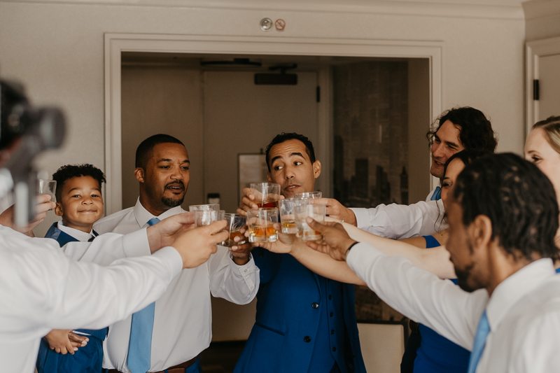 A groom getting ready for his wedding in Baltimore, Maryland by Britney Clause Photography