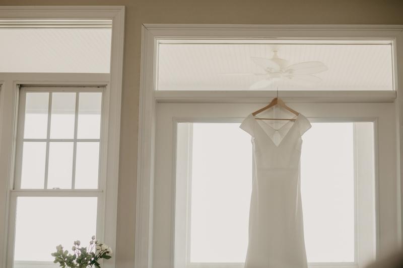 Gorgeous wedding dress from BHLDN for a beach wedding in Folly Beach, South Carolina by Britney Clause Photography