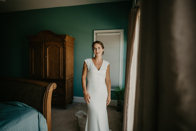 A bride getting ready for her wedding in Folly Beach, South Carolina by Britney Clause Photography