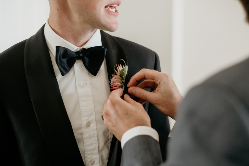 A groom getting ready for his wedding in Folly Beach, South Carolina by Britney Clause Photography