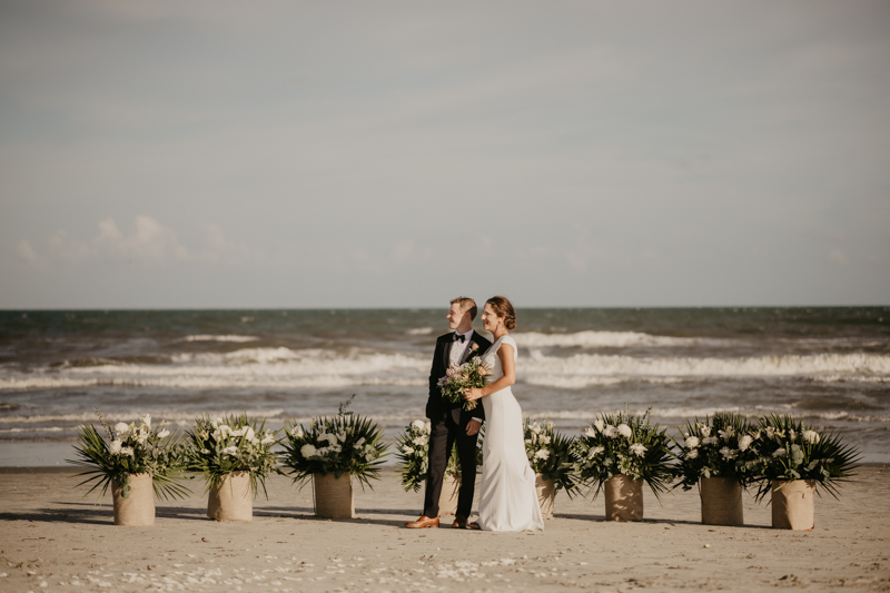 Stunning bride and groom beach wedding portraits in Folly Beach, South Carolina by Britney Clause Photography