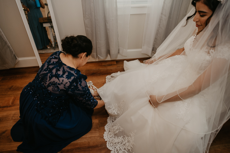 A bride getting ready for her wedding at Historic Rosemont Springs, Virginia by Britney Clause Photography