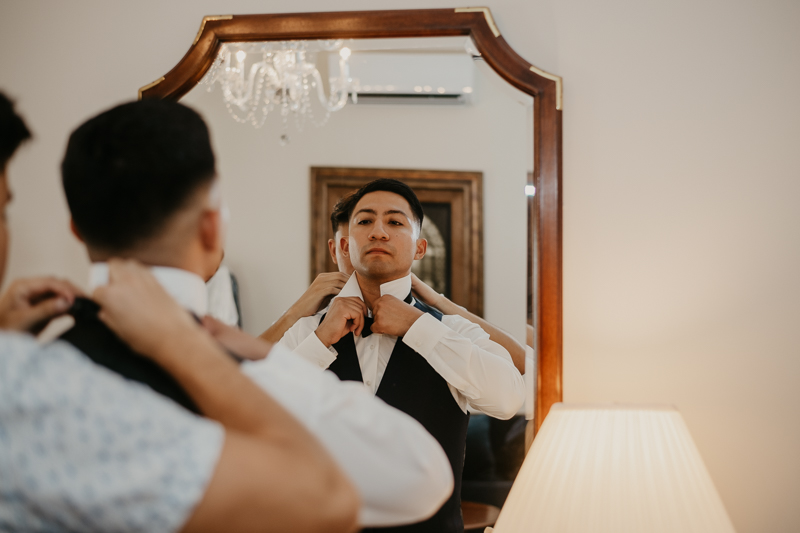 A groom getting ready for his wedding at Historic Rosemont Springs, Virginia by Britney Clause Photography