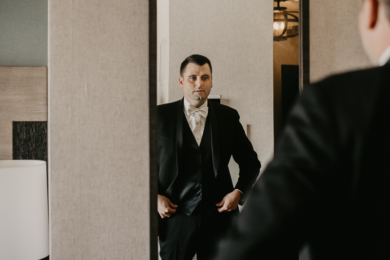 A groom getting ready for his wedding at The Hyatt Regency Chesapeake Bay, Maryland by Britney Clause Photography